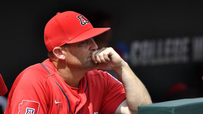 Arizona head coach Jay Johnson watches Coastal Carolina celebrate their 4-3 victory to win the championship after Game 3 of the NCAA College World Series baseball finals in Omaha, Neb., Thursday, June 30, 2016. (AP Photo/Ted Kirk)