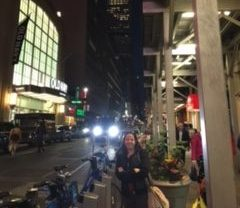 Italian-American, Ms. Lange in front of Empire State Building on Columbus Day