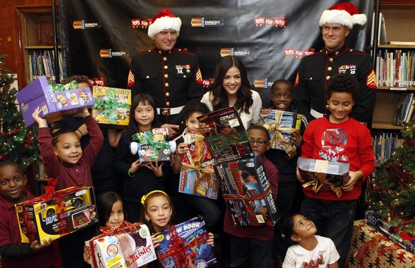 Actress Lucy Hale kicks off the Duracell Power Holiday Smiles program to benefit Toys for Tots by making a surprise visit with battery-operated toys for students at P.S. 64, Tuesday, Nov. 20, 2012, in New York.  The program aims to power 500,000 smiles for families in need with the help of consumers.  Visit Facebook.com/Durecell for more information. (Photo by Jason DeCrow for Duracell)
