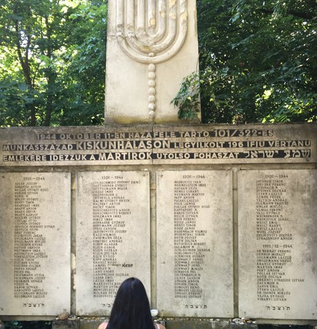 Ms. Lange in front of her fathers Holocaust Memorial