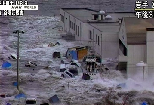 Video image taken from Japans NHK TV March 11, 2011 following the earthquake, a tsunami hits against a building in Miyaku City.