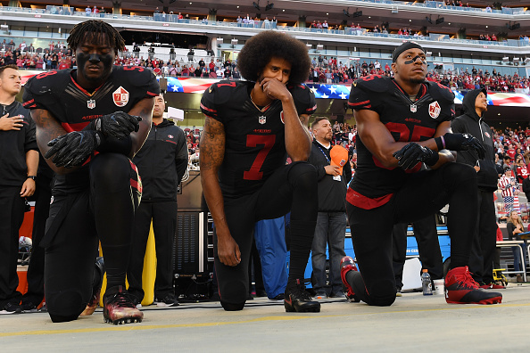 SANTA CLARA, CA - OCTOBER 06:  (L-R) Eli Harold #58, Colin Kaepernick #7, and Eric Reid #35 of the San Francisco 49ers kneel in protest during the national anthem prior to their NFL game against the Arizona Cardinals at Levis Stadium on October 6, 2016 in Santa Clara, California.  (Photo by Thearon W. Henderson/Getty Images)
