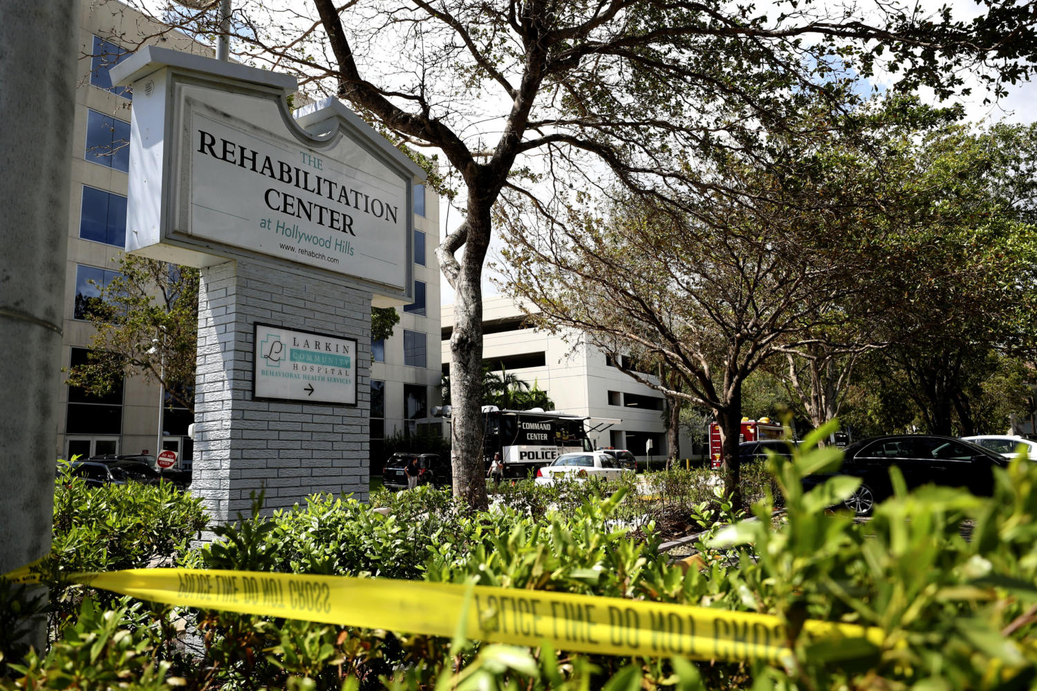 Police surround the Rehabilitation Center in Hollywood Hills, Fla., which had no air conditioning after Hurricane Irma knocked out power, Wednesday, Sept. 13, 2017. Several patients at the sweltering nursing home died in Hurricane Irmas aftermath, raising fears Wednesday about the safety of Floridas 4 million senior citizens amid widespread power outages that could go on for days. (John McCall/South Florida Sun-Sentinel via AP)