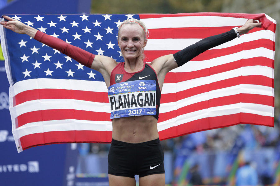 Shalane Flanagan of the United States poses for pictures after crossing the finish line first in the womens division of the New York City Marathon in New York, Sunday, Nov. 5, 2017. (AP Photo/Seth Wenig)