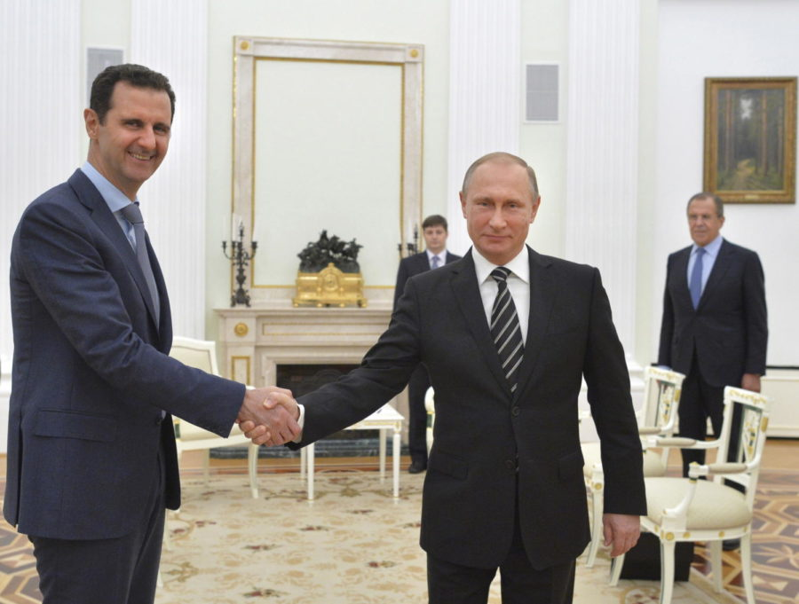Russian President Vladimir Putin (R) shakes hands with Syrian President Bashar al-Assad during a meeting at the Kremlin in Moscow, Russia, in this October 20, 2015 file photo. To match Insight MIDEAST-CRISIS-SYRIA/PUTIN REUTERS/Alexei Druzhinin/RIA Novosti/Kremlin/ Files ATTENTION EDITORS - THIS IMAGE HAS BEEN SUPPLIED BY A THIRD PARTY. IT IS DISTRIBUTED, EXACTLY AS RECEIVED BY REUTERS, AS A SERVICE TO CLIENTS. TPX IMAGES OF THE DAY      - RTX28OUJ