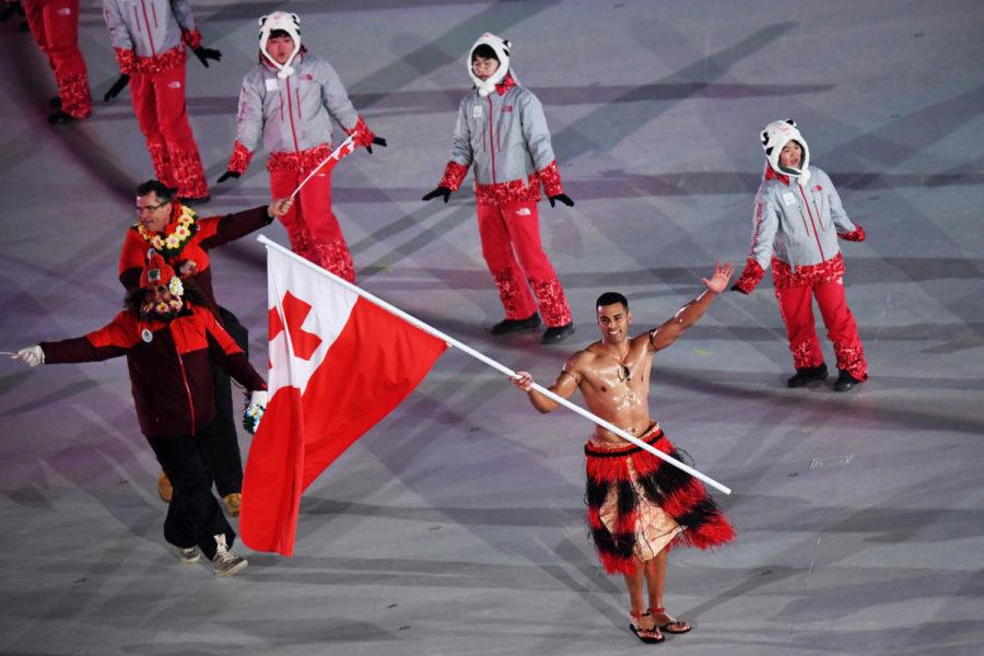 PYEONGCHANG-GUN, SOUTH KOREA - FEBRUARY 09:  Flag bearer Pita Taufatofua of Tonga and teammates enter the stadium during the Opening Ceremony of the PyeongChang 2018 Winter Olympic Games at PyeongChang Olympic Stadium on February 9, 2018 in Pyeongchang-gun, South Korea.  (Photo by Pool - Frank Fife/Getty Images)