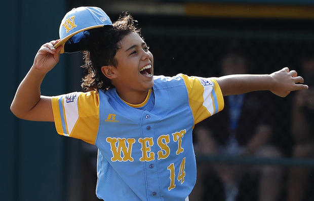 Honolulu, Hawaii pitcher Kaolu Holt begins to celebrate after pitching a complete game, 3-0 shutout in the Little League World Series Championship baseball game against South Korea in South Williamsport, Pa., Sunday, Aug. 26, 2018. (AP Photo/Gene J. Puskar).