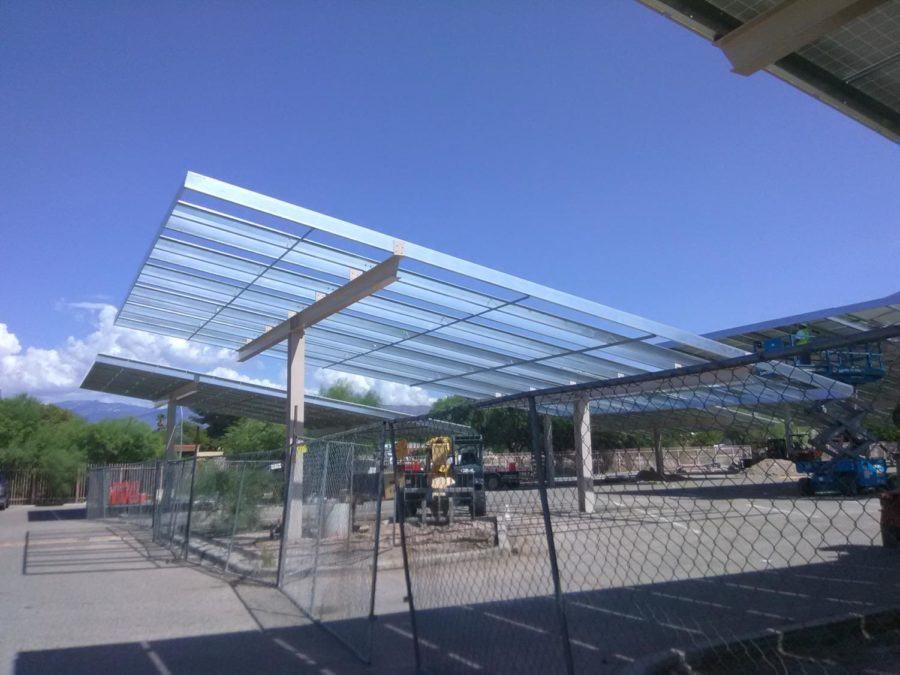 Solar panels being installed in the student parking lot