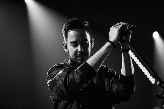BURBANK, CA - MAY 22: (EDITORS NOTE: Image has been converted to black and white.) Mike Shinoda of Linkin Park performs on stage at the iHeartRadio Album Release Party presented by State Farm at the iHeartRadio Theater Los Angeles on May 22, 2017 in Burbank, California.  (Photo by Rich Fury/Getty Images for iHeartMedia)