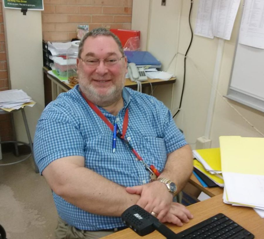 Mr.+Bellows+%28survivor%29+working+at+his+desk+in+his+classroom+
