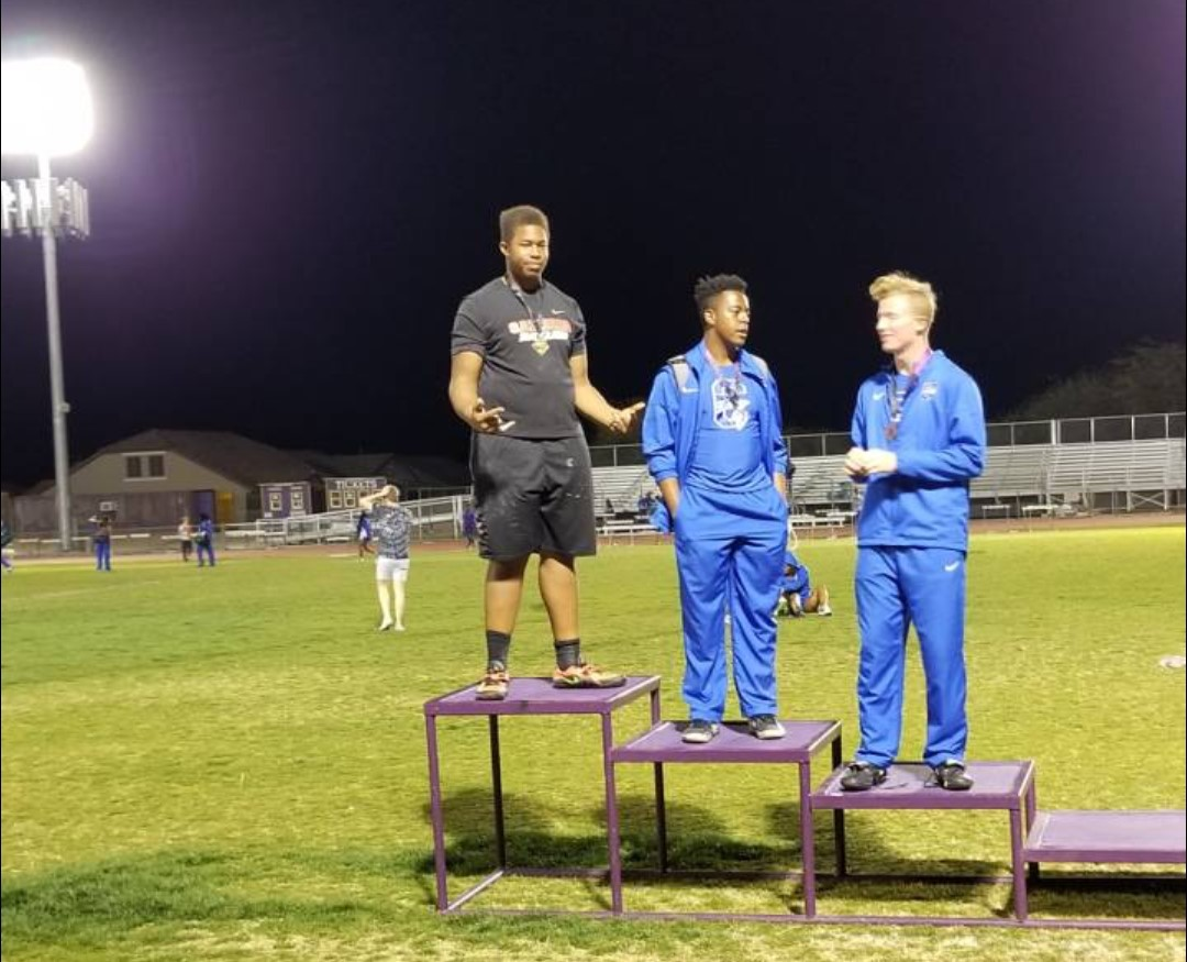 Kingsley (far left) accepting a first place award at Marana Invitational