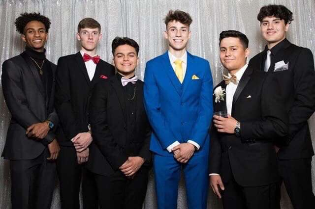 Racham at the 2019 Senior Prom (third in from the left)