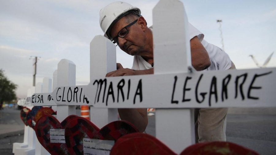 Greg Zanis sets up his white crosses in honor and remembrance of El Paso victims