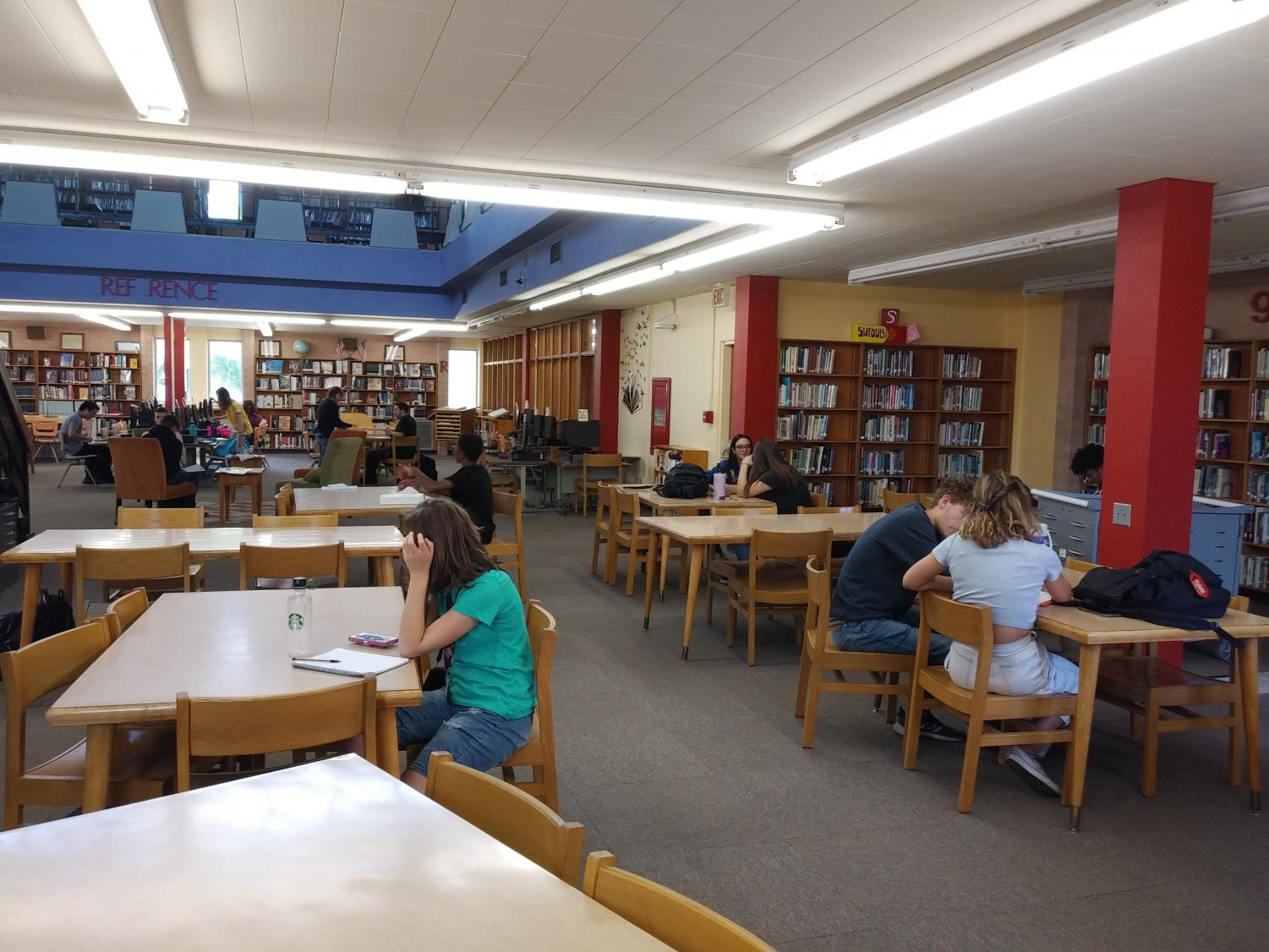 Students working in the library during tutoring.