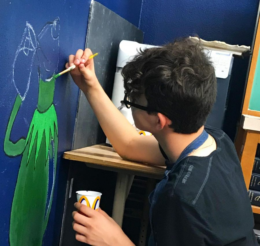 Hard at work: Jordan Myers on the second day of painting.