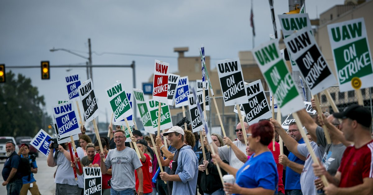 UAW Workers picketing outside General Motor's factories and facilities (from TIME.com)