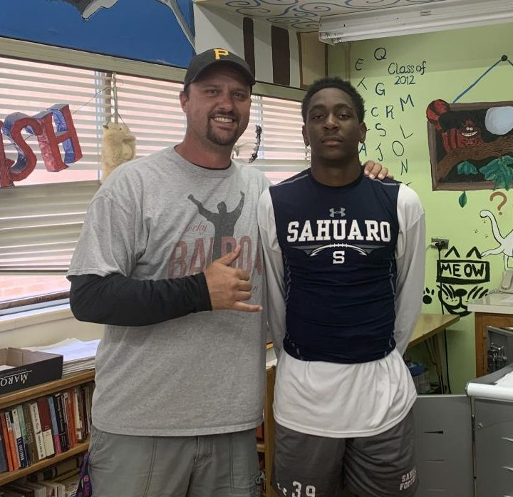 Jamir Gasaway and his father-figure, Coach McKee who inspires him every day