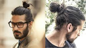 2010-+The+Era+of+the+Man+Bun%21+Curly%2C+wavy%2C+or+straight+hair+is+tied+back+into+a+top+knot+on+men%27s+heads.+They+grow+out+their+hair+on+top+and+shave+the+rest.+Be+right+back%2C+going+to+hop+on+this+bandwagon%21