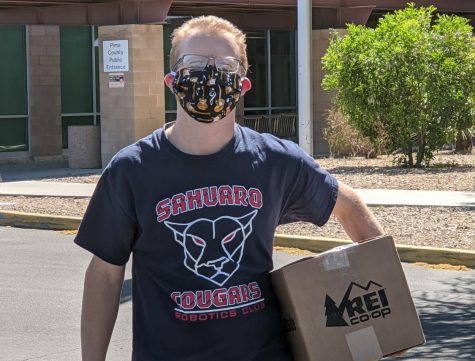 Mr. Davis delivering a box of face shields he made