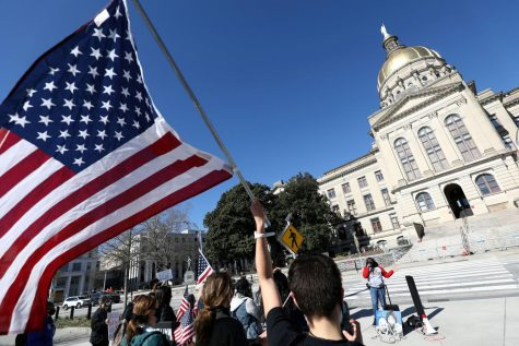 People gather outside the Georgia Capitol last month to demonstrate against proposed voting legislation. (Dustin Chambers/Reuters)