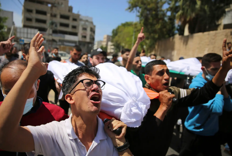 Palestinians carry bodies of those killed overnight in their homes by airstrikes.
