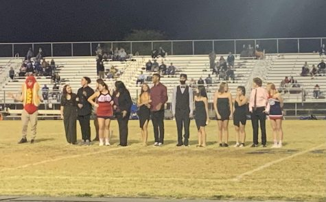 The nominees of this years homecoming awaiting results on the football field.